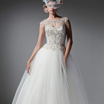 Modern and romantic, this pleated tulle and Chic organza ball gown sparkles with a Swarovski crystal encrusted bodice. A demure illusion neckline, back, and cap-sleeves are sprinkled with glittering crystals. Finished with crystal buttons over zipper closure. <img height='0' width='0' alt='' src='http://ads.zankyou.com/mn8v' />