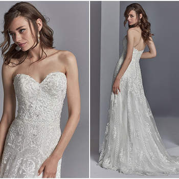 "Embroidered lace motifs accented in beading and Swarovski crystals cascade over tulle in this sheath wedding dress, completing the strapless sweetheart neckline and scallop lace hemline. Finished with covered buttons over zipper and inner corset closure.  <a href=""https://www.maggiesottero.com/sottero-and-midgley/skylar/11230?utm_source=zankyou&amp;utm_medium=gowngallery"" target=""_blank"">Sottero and Midgley</a>"