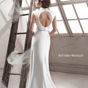 "Dramatic Desta satin sheath with mandarin collar features sexy keyhole back and Swarovski crystal embellishment adorning a crystal belt. Finished with zipper closure.  <a href=""http://www.sotteroandmidgley.com/dress.aspx?style=4SC944"" target=""_blank"">Sottero &amp; Midgley Platinum 2015</a>"