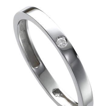 Sencillo modelo de alianza de bodas en oro blanco y un diamante central. Foto: Chancejoyas. http://www.chancejoyas.com