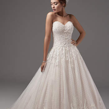 "Beaded lace appliqués dance across the bodice and illusion back of this shimmering ballgown, while a striking lace hem and layers of tulle crosshatching add texture and dimension to the skirt. Featuring a scalloped sweetheart neckline. Finished with covered buttons and zipper closure.  <a href=""https://www.maggiesottero.com/sottero-and-midgley/jewel/10232?utm_source=mywedding.com&utm_campaign=spring17&utm_medium=gallery"" target=""_blank"">Sottero and Midlgey</a>"