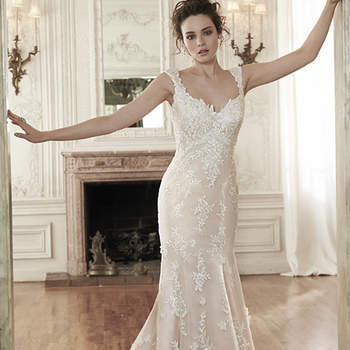"A stunning A-Line, this wedding gown features floral lace appliqués adorning an airy, tulle overlay. An unexpected plunging back adds a touch of drama. Finished with covered buttons over zipper closure.  <a href=""http://www.maggiesottero.com/dress.aspx?style=5MC023"" target=""_blank"">Maggie Sottero Spring 2015</a>"