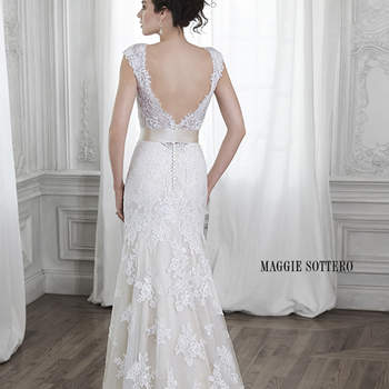 "Dreamy lace and tulle adorn this A-Line wedding dress with dramatic V-neckline and back, accented with scallops and adorned with optional ribbon belt at the waist. Finished with covered button over zipper closure.  <a href=""http://www.maggiesottero.com/dress.aspx?style=5MS015"" target=""_blank"">Maggie Sottero Spring 2015</a>"