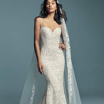 "<a href=""https://www.maggiesottero.com/maggie-sottero/gwendolyn/11479"">Maggie Sottero</a>  Beaded lace motifs cascade over tulle in this sexy fit-and-flare wedding dress, featuring a sweetheart neckline and beaded spaghetti straps. Finished with covered buttons over zipper and inner corset closure. Detachable veil accented in beaded lace motifs sold separately. Detachable train accented in beaded lace sold separately."