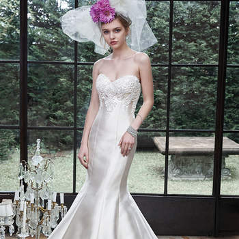 "Rich and luxurious Elodie Mikado creates this dramatic mermaid wedding dress, complete with voluminous skirt, and lace adorned bodice, sparkling with Swarovski crystals. Finished with sweetheart neckline and corset closure.  <a href=""http://www.maggiesottero.com/dress.aspx?style=5MS619"" target=""_blank"">Maggie Sottero</a>"