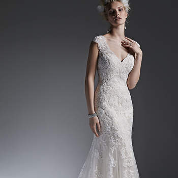 Beaded lace appliqués adorn tulle in this stunning modified A-line wedding dress with a romantic keyhole back. Finished with covered buttons over zipper closure. <img height='0' width='0' alt='' src='http://ads.zankyou.com/mn8v' />