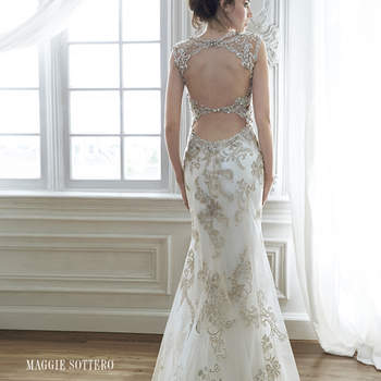 "Exquisite bead embroidered lace adorns the bodice in this sheath wedding dress with Swarovski crystal neckline. Complete with stunning double keyhole back. Finished with zipper closure.  <a href=""http://www.maggiesottero.com/dress.aspx?style=5MD056"" target=""_blank"">Maggie Sottero Spring 2015</a>"