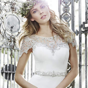 "Soft romance kissed with glamour, this understated Aurora chiffon sheath features a fully beaded Swarovski crystal neckline draping the shoulder and tracing the back. An illusion sweetheart neckline and Swarovski crystal belt at the waist complete the look. Finished with crystal button over zipper back closure.  <a href=""http://www.maggiesottero.com/dress.aspx?style=5HS160"" target=""_blank"">Maggie Sottero Spring 2015</a>"