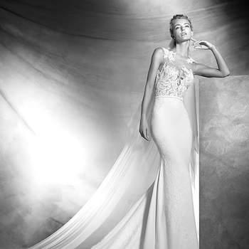Vestido sexy de noiva em crepe, estilo sereia, com detalhes em nude. Corpo transparente em tule ilusão com aplicações em renda rebrodé. Saia em crepe, estilo sereia, com aplicações em renda rebrodé. Cinto pequeno em crepe.