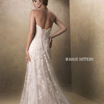 "With an eye to timeless romance, this slim A-line design features a delicate, sweetheart neckline and gorgeous beaded lace motifs dancing across tulle. Available with corset back or zipper closure. Detachable cap-sleeves offered separately. Extended train also available (Emma Marie).  <a href=""http://www.maggiesottero.com/dress.aspx?style=13533"" target=""_blank"">Maggie Sottero Platinum 2015</a>"