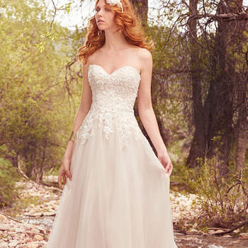 "Lace appliqués, delicate pearls, and shimmering sequins adorn the bodice of this sweet and understated A-line, featuring a tulle skirt and strapless sweetheart neckline. Finished with covered buttons over zipper closure. Detachable tulle belt included.  <a href=""https://www.maggiesottero.com/maggie-sottero/harmony/10103?utm_source=mywedding.com&amp;utm_campaign=spring17&amp;utm_medium=gallery"" target=""_blank"">Maggie Sottero</a>"