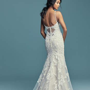 "<a href=""https://www.maggiesottero.com/maggie-sottero/riley/11502"">Maggie Sottero</a>  Beaded lace motifs dance over sequin tulle in this soft yet alluring sheath wedding gown, completing the unique illusion keyhole back. Beaded spaghetti straps complete the elegant scoop neckline. Finished with covered buttons over zipper closure."