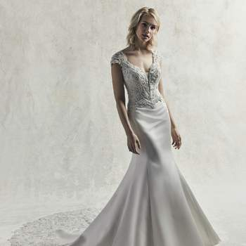 Beaded lace motifs and Swarovski crystals evoke vintage glamour in this Carlo satin fit-and-flare wedding dress.