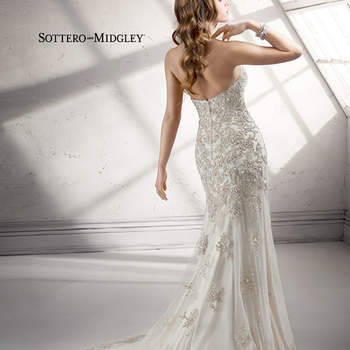 Swarovski crystal beaded embroidered lace sparkles atop tulle over Evita satin in this sheath gown with romantic sweetheart neckline. Pearl buttons adorn an inner corset zipper closure.