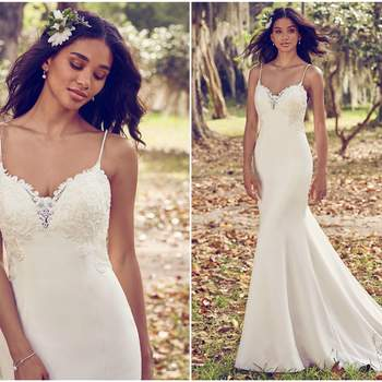 "Beaded lace motifs accent the bodice, illusion sweetheart neckline, illusion back, and illusion cutout train in this Aldora Crepe sheath wedding dress. Complete with beaded spaghetti straps and back ruching. Finished with crystal buttons and zipper closure.  <a href=""https://www.maggiesottero.com/maggie-sottero/zoey/11201?utm_source=zankyou&amp;utm_medium=gowngallery"" target=""_blank"">Maggie Sottero</a>"