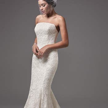 "This modern and sophisticated strapless fit-and-flare features floral lace motifs and a chic straight neckline. Finished with covered buttons over zipper and inner corset closure.  <a href=""https://www.maggiesottero.com/sottero-and-midgley/linley/10236?utm_source=mywedding.com&utm_campaign=spring17&utm_medium=gallery"" target=""_blank"">Sottero and Midlgey</a>"