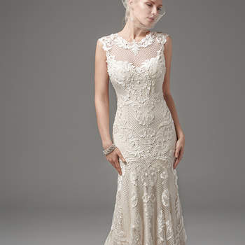 "This unique and glamorous fit-and-flare features laser-cut lace over textured netting and Viva jersey lining with an illusion jewel over scoop neckline, illusion cap-sleeves, and illusion open back, all trimmed with lace appliqués. Finished with covered buttons and zipper closure.  <a href=""https://www.maggiesottero.com/sottero-and-midgley/suzanne/10252?utm_source=mywedding.com&utm_campaign=spring17&utm_medium=gallery"" target=""_blank"">Sottero and Midgley</a>"