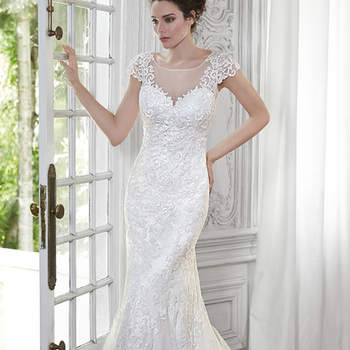 "The epitome of modern romance is found in this A-Line gown, constructed of embroidered lace appliqués. Complete with an illusion sweetheart neckline and elegant cap-sleeves. Finished with covered button over zipper closure.  <a href=""http://www.maggiesottero.com/dress.aspx?style=5MT080"" target=""_blank"">Maggie Sottero Spring 2015</a>"