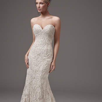 "This alluring fit-and-flare features striking lace motifs, a low back, and a sexy sweetheart neckline accented with a shimmer of sequins and beading. Finished with covered buttons over zipper closure. Detachable illusion cap-sleeves accented in lace appliqués sold separately.  <a href=""https://www.maggiesottero.com/sottero-and-midgley/hadley/10227?utm_source=mywedding.com&utm_campaign=spring17&utm_medium=gallery"" target=""_blank"">Sottero and Midgley</a>"