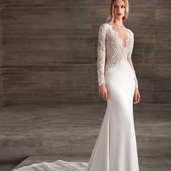 Un modelo que se adapta a la silueta de la mujer para resaltar de forma elegante sus curvas. Un vestido de manga larga que contrasta por su doble tejido.