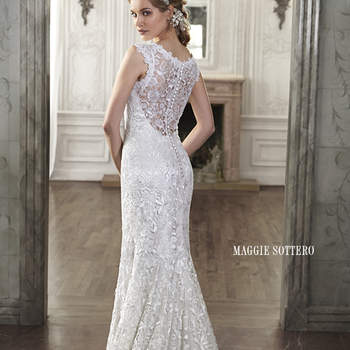 "This lace sheath wedding dress balances elegant details of a scalloped hemline with dramatic touches, such as an illusion plunging sweetheart neckline. An illusion lace back creates drama and sophistication. Finished with covered button over zipper closure.  <a href=""http://www.maggiesottero.com/dress.aspx?style=5MT014"" target=""_blank"">Maggie Sottero Spring 2015</a>"