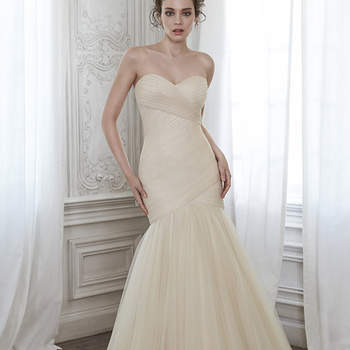 "A stunning fit and flare wedding dress featuring pleated tulle and flaring into a voluminous skirt, complete with romantic sweetheart neckline and finished with corset closure. <a href=""https://www.maggiesottero.com/maggie-sottero/lacey/8284"" target=""_blank"">Maggie Sottero</a>"