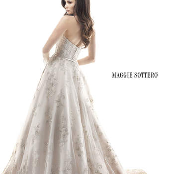 "Fall in love all over again in this dreamy ballgown, delicately placed embroidered lace on tulle sparkles with metallic thread and Swarovski crystals. Complete with a delicate waistband and zipper over inner elastic closure.  <a href=""http://www.maggiesottero.com/dress.aspx?style=4MS901"" target=""_blank"">Maggie Sottero Platinum 2015</a>"
