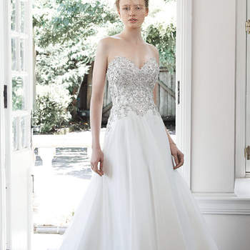 "With a fully encrusted Swarovski crystal and pearl bodice and flowing skirt, this Lucetta organza A-line wedding dress is the epitome of fairytale romance, accented with classic sweetheart neckline. Finished with crystal buttons over zipper and inner elastic closure.  <a href=""http://www.maggiesottero.com/dress.aspx?style=5MC658"" target=""_blank"">Maggie Sottero</a>"
