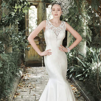 "A sensational illusion back, edged with hand-placed appliqués, takes center stage in this gorgeous Elodie Mikado fit and flare wedding dress. A Swarovski crystal and pearl illusion sweetheart neckline accents the look. Finished with crystal buttons over zipper closure.  <a href=""http://www.maggiesottero.com/dress.aspx?style=5MR708"" target=""_blank"">Maggie Sottero</a>"
