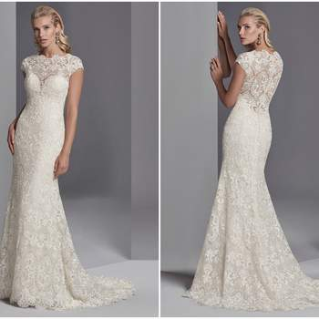 "This boho wedding gown features allover lace motifs in a sheath silhouette, with sheer lace comprising the jewel over sweetheart neckline, cap-sleeves, and scoop back. Finished with covered buttons over zipper closure.  <a href=""https://www.maggiesottero.com/sottero-and-midgley/zayn-rose/11233?utm_source=zankyou&amp;utm_medium=gowngallery"" target=""_blank"">Sottero and Midgley</a>"