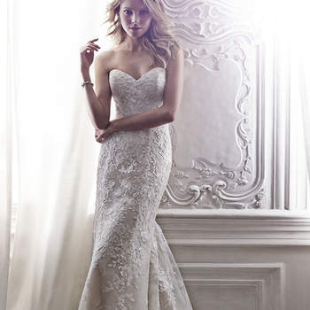 "This lace A-Line gown channels timeless elegance with its classic sweetheart neckline, cascading floral lace appliqués, lace-trimmed hemline and optional lace cap-sleeves. Finished with corset closure or crystal button over zipper closure with inner corset.  <a href=""http://www.maggiesottero.com/dress.aspx?style=5MS146LU"" target=""_blank"">Maggie Sottero Spring 2015</a>"