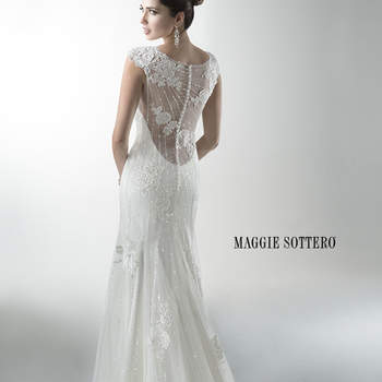 "Mirroring the sophistication of Savannah, this sister dress includes sequined embellished lace over a separate slip dress. Cap-sleeves accent a low, illusion back. Finished with crystal buttons over zipper back closure. Offered with Monroe slip dress or slip dress with raised back.  <a href=""http://www.maggiesottero.com/dress.aspx?style=4MW060"" target=""_blank"">Maggie Sottero Platinum 2015</a>"