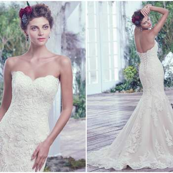 "Lace artfully placed atop tulle adds sophistication to this feminine fit and flare wedding dress. Finished with a soft sweetheart neckline, scalloped hemline, and corset closure.   <a href=""https://www.maggiesottero.com/maggie-sottero/valerie/9694"" target=""_blank"">Maggie Sottero</a>"