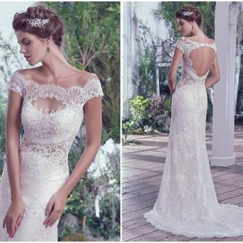 "Embroidered and beaded illusion lace featuring Swarovski crystals adds drama and dimension to this bateau neckline, off-the-shoulder sleeves, and illusion waistline. An elegant train falls behind this sheath silhouette. Finished with a statement making keyhole back and pearl buttons over zipper closure.   <a href=""https://www.maggiesottero.com/maggie-sottero/sipriana/9709"" target=""_blank"">Maggie Sottero</a>"