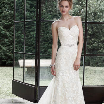 "Dreamy lace and tulle combine to create this elegant fit and flare wedding dress, accented with timeless sweetheart neckline. A glittering Swarovski crystal motif on an optional grosgrain ribbon belt adds a touch of drama. Finished with covered buttons over zipper and inner elastic closure. <a href=""http://www.maggiesottero.com/dress.aspx?style=5MS694"" target=""_blank"">Maggie Sottero</a>"