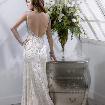 This breathtaking tulle sheath with illusion neckline features mirrored jewels and sparkling Swarovski crystals atop beaded embroidery. Complete with zipper and crystal button back closure.