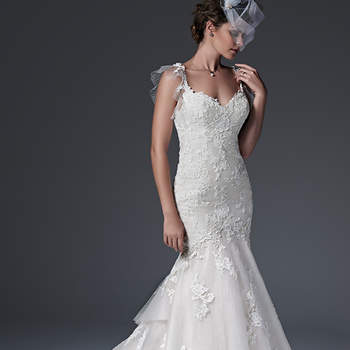 Chic fit and flare wedding dress with floral lace appliqués drifting atop a dot tulle overlay, accented with a delicate illusion tulle back and flutter sleeves. Finished with dramatic, tiered train, sweetheart neckline and pearl buttons over zipper closure. <img height='0' width='0' alt='' src='http://ads.zankyou.com/mn8v' />