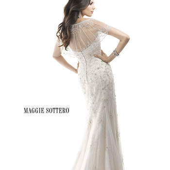 "Drama, sophistication and glamour come together in this gorgeous, beaded slim A-line gown. Sequin embellished tulle over Valentina Satin adds to the twinkle factor, while an optional Swarovski crystal tulle caplet drapes the shoulders. Finished with zipper over inner elastic closure.  <a href=""http://www.maggiesottero.com/dress.aspx?style=4MS842"" target=""_blank"">Maggie Sottero Platinum 2015</a>"