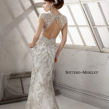 Bold metallic embroidered floral lace appliques adorn tulle in this sheath with Swarovski crystal beaded neckline and keyhole back, finished with zipper closure.