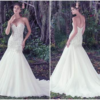 "Perfect for the truly romantic bride, embellished lace adorns the bodice of this Chic organza fit and flare wedding dress. Finished with a classic sweetheart neckline and covered buttons over zipper and inner corset closure.   <a href=""https://www.maggiesottero.com/maggie-sottero/baxter/9697"" target=""_blank"">Maggie Sottero</a>"