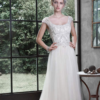 "The epitome of romance is found in this tulle slim A-line wedding dress, featuring a Swarovski crystal and pearl beaded bodice, accented with scoop neckline and plunging scoop back. Finished with delicate illusion cap-sleeves, crystal buttons and zipper closure.  <a href=""http://www.maggiesottero.com/dress.aspx?style=5MD611"" target=""_blank"">Maggie Sottero</a>"