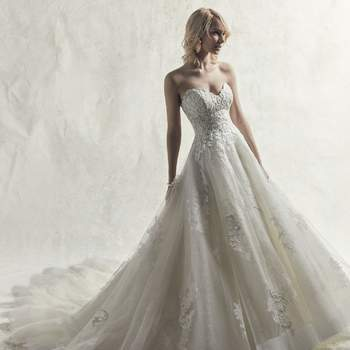 Embroidered lace motifs cascade over layers of sequin and textured tulle in this elegant princess wedding dress.