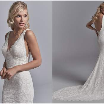 "Allover lace motifs cascade over crosshatched tulle in this fit-and-flare wedding dress. Delicate beading accents the illusion V-neckline, waistline, straps, and V-back. Lined with Inessa Jersey for a luxe fit. Finished with zipper closure.  <a href=""https://www.maggiesottero.com/sottero-and-midgley/regan/11227?utm_source=zankyou&amp;utm_medium=gowngallery"" target=""_blank"">Sottero and Midgley</a>"
