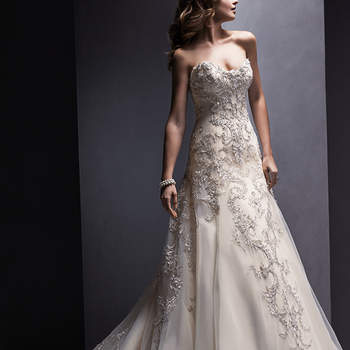 Return to romance in this Marquice organza A-line wedding gown with glimmering lace appliqués. Complete with strapless, sweetheart neckline and finished with covered button over zipper and inner corset closure. <img height='0' width='0' alt='' src='http://ads.zankyou.com/mn8v' />