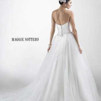 "Layers of soft tulle create this dreamy ballgown, complete with cross-body tulle ruching and beaded floral embellishment at the waist. Finished with covered button over zipper and inner corset closure.  <a href=""http://www.maggiesottero.com/dress.aspx?style=4MT943"" target=""_blank"">Maggie Sottero Platinum 2015</a>"