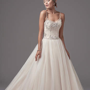 "A bodice of Swarovski crystals and crosshatch embroidery accented in pearls adds luster and opulence to this tulle ballgown, featuring embellished spaghetti straps and illusion trim along the scoop neck and open back. Finished with covered buttons over zipper closure.   <a href=""https://www.maggiesottero.com/sottero-and-midgley/jakayla/10231?utm_source=mywedding.com&utm_campaign=spring17&utm_medium=gallery"" target=""_blank"">Sottero and Midgley</a>"