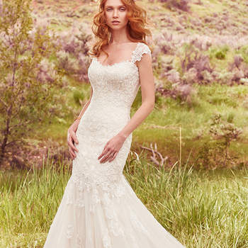 "This elegant fit-and-flare features lovely lace motifs layered over tulle. A double-border lace hemline on the train completes this breathtaking gown. Finished with corset closure, or covered buttons over zipper and inner elastic closure. Detachable cap-sleeves with lace appliqués sold separately. <a href=""https://www.maggiesottero.com/maggie-sottero/callie/10090?utm_source=mywedding.com&amp;utm_campaign=spring17&amp;utm_medium=gallery"" target=""_blank"">Maggie Sottero</a>"