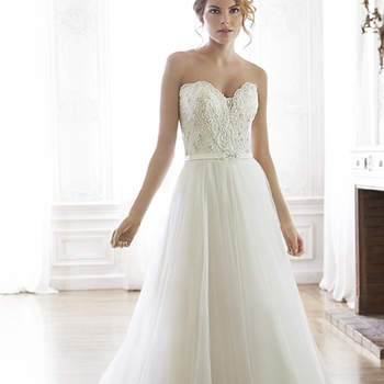 Twinkling Swarovski crystals accent the bodice of this romantic tulle A-line wedding dress. Complete with a sweetheart neckline and finished with crystal button over zipper and inner corset closure.