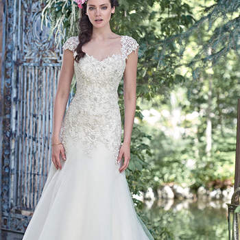"Elegant and sophisticated, this A-line wedding dress combines a decadent, Swarovski crystal beaded lace bodice with an ethereal Chic organza and tulle skirt, perfect for the truly romantic bride. Finished with sweetheart neckline and corset closure. Detachable beaded lace cap-sleeves sold separately. <a href=""www.maggiesottero.com/maggie-sottero/ladonna/9495"" target=""_blank"">Maggie Sottero/a&gt;"