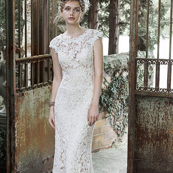 "Elaborate patterned lace lays atop a Royal satin slip in this breathtaking sheath wedding dress, complete with stunning illusion lace back, romantic illusion sweetheart neckline and feminine cap-sleeves. Finished with covered buttons over zipper closure.  <a href=""http://www.maggiesottero.com/dress.aspx?style=5MT655"" target=""_blank"">Maggie Sottero</a>"
